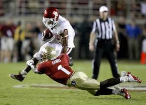 Photo - Oklahoma's Dominique Whaley (8) tries to get past Florida's Mike Harris (1) during a college football game between the University of Oklahoma ( OU) and Florida State (FSU) at Doak Campbell Stadium in Tallahassee, Fla., Saturday, Sept. 17, 2011. Oklahoma won 23-13. Photo by Bryan Terry