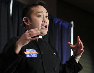 "Photo - The Rev. Leo Patalinghug, founder of the ""Grace Before Meals"" movement, speaks at the Oklahoma Catholic Women's Conference Feb. 18 at the Clarion Meridian Hotel & Convention Center in Oklahoma City. <strong>PAUL HELLSTERN</strong>"