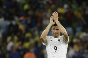 Photo - France's Olivier Giroud applauds his supporters after the group E World Cup soccer match between Ecuador and France at the Maracana Stadium in Rio de Janeiro, Brazil, Wednesday, June 25, 2014. France drew 0-0 with 10-man Ecuador to advance to the second round of the World Cup, while the South Americans will be going home from the tournament. (AP Photo/Christophe Ena)