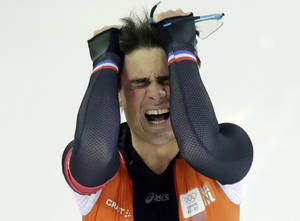Photo - Silver medallist Jan Smeekens of the Netherlands pulls his hair after completing his second heat for the men's 500-meter speedskating race at the Adler Arena Skating Center at the 2014 Winter Olympics, Monday, Feb. 10, 2014, in Sochi, Russia. (AP Photo/David J. Phillip)