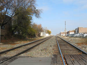 Photo - This photo shows one area near downtown Oklahoma City that would be included in a proposed quiet zone. Kamps 1910 Cafe and Java Dave's are to the right of these railroad tracks between NW 9 and NW 10 while Steve Mason's 9th Street restaurants and shops are to the left. <strong>STEVE LACKMEYER - BUSINESS WRITER</strong>