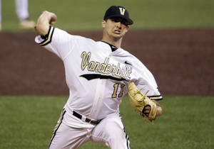 Photo - Vanderbilt starting pitcher Tyler Beede throws against Xavier in the second inning of an NCAA college baseball regional tournament game Friday, May 30, 2014, in Nashville, Tenn. (AP Photo/Mark Humphrey)