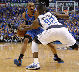 Photo - Oklahoma City's Russell Westbrook (0) tries to get around DeShawn Stevenson (92) of Dallas during game 2 of the Western Conference Finals in the NBA basketball playoffs between the Dallas Mavericks and the Oklahoma City Thunder at American Airlines Center in Dallas, Thursday, May 19, 2011. Photo by Bryan Terry, The Oklahoman