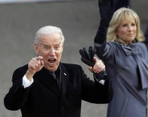 photo - FILE - In this Jan. 21, 2013, photo, Vice President Joe Biden reacts with his wife, Jill, as they walk down Pennsylvania Avenue en route to the White House, Monday, Jan. 21, 2013, in Washington, during the Inaugural Parade during the 57th Presidential Inauguration parade after the ceremonial swearing-in of President Barack Obama. Biden in 2016? The inauguration is barely over but the vice president already is dropping plenty of hints that he might have another political act. Biden packed his schedule with events and receptions attended by party stalwarts throughout the long weekend of inauguration festivities, stoking speculation he may be laying the groundwork to carry the torch from Obama.  (AP Photo/Gerald Herbert)