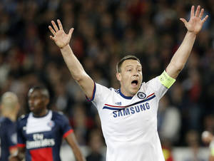 Photo - Chelsea's John Terry reacts during the Champions League quarterfinal first leg soccer match between PSG and Chelsea, at the Parc des Princes stadium, in Paris, Wednesday, April 2, 2014. (AP Photo/Christophe Ena)