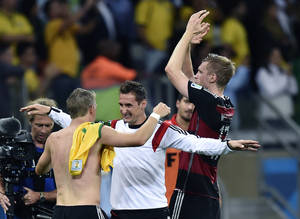Photo - Germany's Bastian Schweinsteiger, left, and Miroslav Klose  celebrate after the World Cup semifinal soccer match between Brazil and Germany at the Mineirao Stadium in Belo Horizonte, Brazil, Tuesday, July 8, 2014. Germany won the match 7-1. (AP Photo/Martin Meissner)