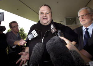"photo - FILE - In this Feb. 22, 2012 file photo, Kim Dotcom, the founder of the file-sharing website Megaupload, comments after he was granted bail and released in Auckland, New Zealand. Indicted Megaupload founder Kim Dotcom has launched a new file-sharing website in a defiant move against the U.S. prosecutors who accuse him of facilitating massive online piracy. The colorful entrepreneur unveiled the ""Mega"" site ahead of a lavish gala and press conference planned at his New Zealand mansion on Sunday night, Jan. 20, 2013. (AP Photo/New Zealand Herald, Brett Phibbs, File) NEW ZEALAND OUT, AUSTRALIA OUT"