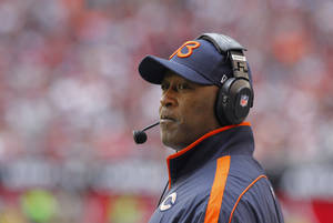 Photo - FILE -- In a Dec. 23, 2012 file photo Chicago Bears head coach Lovie Smith watches his team during the first half of an NFL football game against the Arizona Cardinals in Glendale, Ariz.  The Chicago Bears have fired coach Lovie Smith after the team missed the playoffs for the fifth time in six seasons.  (AP Photo/Rick Scuteri/file)