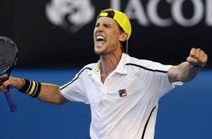 Photo - Andreas Seppi of Italy celebrates after defeating Lleyton Hewitt of Australia in their first round match at the Australian Open tennis championship in Melbourne, Australia, Tuesday, Jan. 14, 2014. (AP Photo/Eugene Hoshiko)