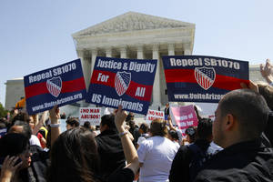 "photo - Supporters of immigration reform rally outsode the Supreme Court in Washington, Wednesday, April 25, 2012, where the court held a hearing on Arizona's ""show me your papers"" immigration law. (AP Photo/Charles Dharapak) ORG XMIT: DCCD118"