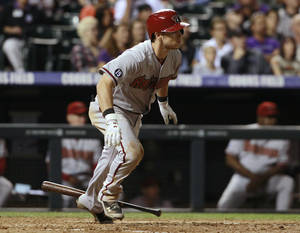 Photo - Arizona Diamondbacks' Chris Owings heads to first on a single against the Colorado Rockies in the fifth inning of a baseball game in Denver on Saturday, Sept. 21, 2013. (AP Photo/David Zalubowski)