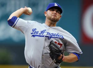 Photo - Los Angeles Dodgers starting pitcher Ricky Nolasco throws to a Colorado Rockies batter during the first inning of a baseball game, Tuesday, Sept. 3, 2013, in Denver. (AP Photo/Jack Dempsey)