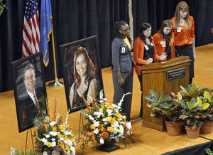 Photo - Former players of the Oklahoma State women's basketball team speak during the memorial service for Oklahoma State head basketball coach Kurt Budke and assistant coach Miranda Serna at Gallagher-Iba Arena on Monday, Nov. 21, 2011 in Stillwater, Okla. The two were killed in a plane crash along with former state senator Olin Branstetter and his wife Paula while on a recruiting trip in central Arkansas last Thursday. Photo by Chris Landsberger, The Oklahoman