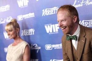 Photo -   Jesse Tyler Ferguson, right, and Jaime Pressly attend the Variety and Women in Film Pre-Emmy Event at Scarpetta on Friday, Sept. 21, 2012, in Beverly Hills, Calif. (Photo by Matt Sayles/Invision/AP)