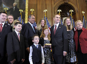 Photo - House Speaker John Boehner of Ohio re-enacts the swearing in of Rep. James Lankford, R-Okla., Wednesday, Jan. 5, 2011, on Capitol Hill in Washington. (AP Photo/Susan Walsh)