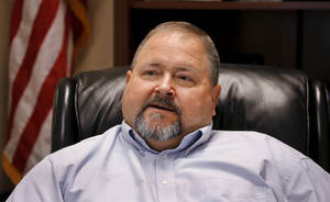 Photo - Chris Ross, district attorney for Pontotoc County, discusses the murder conviction of Karl Fontenot in his office in Ada. Ross says he remains confident that Fontenot is guilty. <strong>Jim Beckel - THE OKLAHOMAN</strong>