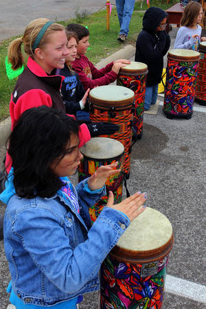 Photo - Monroe Elementary School student entertain the crowd Sunday before the Cleveland County CROP Walk to Stop Hunger.