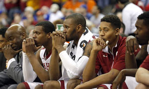 Photo - The Oklahoma bench watches the last seconds of the Phillips 66 Big 12 Men's basketball championship tournament game between the University of Oklahoma and Iowa State at the Sprint Center in Kansas City, Thursday, March 14, 2013. Photo by Sarah Phipps, The Oklahoman