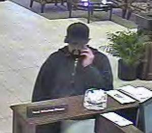 Photo - This photo shows a man believed to have robbed the MidFirst Bank branch at 13240 N May Ave. on Thursday in Oklahoma City. PHOTO PROVIDED BY FBI <strong></strong>