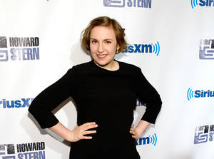 "Photo - FILE - In this Jan. 31, 2014 file photo, actress Lena Dunham attends ""Howard Stern's Birthday Bash,"" presented by SiriusXM, at the Hammerstein Ballroom in New York. From Wednesday, May 28, 2014 to Saturday, tens of thousands of publishers, authors, agents and librarians will meet at the Jacob K. Javits Center in New York for a convention predominantly organized by whites, spotlighting books predominantly written, edited and published by whites. Tavis Smiley is the only non-white among the 15 scheduled marquee author speakers, who also include Dunham and Anjelica Huston.   (Photo by Evan Agostini/Invision/AP, file)"