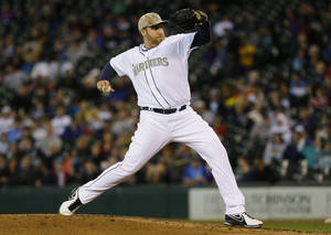Photo - Seattle Mariners starting pitcher Aaron Harang throws against the San Diego Padres in the sixth inning of a baseball game, Monday, May 27, 2013, in Seattle. (AP Photo/Ted S. Warren)