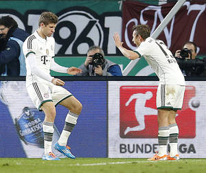 Photo - Bayern's Thomas Mueller, left, and Bayern's Rafinha of Brazil celebrate after scoring  during the German first division Bundesliga soccer match between Hannover 96 and Bayern Munich in Hannover, Germany, Sunday, Feb. 23, 2014. (AP Photo/Frank Augstein)