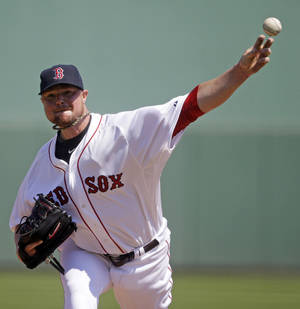 Photo - Boston Red Sox starting pitcher Jon Lester throws in the first inning of an exhibition baseball game against the Tampa Bay Rays in Fort Myers, Fla., Monday, March 10, 2014. (AP Photo/Gerald Herbert)