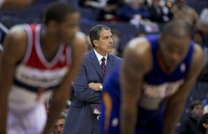 Photo - Washington Wizards coach Randy Wittman looks at the clock during the second half of an NBA basketball game against the Phoenix Suns in Washington, Wednesday, March 26, 2014. The Suns won 99-93. (AP Photo/Manuel Balce Ceneta)