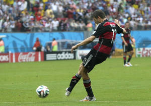 Photo - Germany's Thomas Mueller scores the opening goal during the group G World Cup soccer match between the USA and Germany at the Arena Pernambuco in Recife, Brazil, Thursday, June 26, 2014. (AP Photo/Petr David Josek)