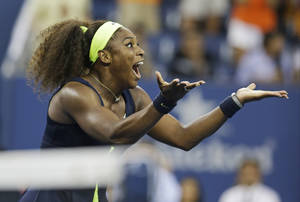 Photo -   Serena Williams reacts after beating Victoria Azarenka, of Belarus, in the championship match at the 2012 US Open tennis tournament, Sunday, Sept. 9, 2012, in New York. Two points from defeat, Williams suddenly regained her composure to come back and win the last four games, beating No. 1-ranked Azarenka 6-2, 2-6, 7-5 on Sunday for her fourth U.S. Open title and 15th Grand Slam title overall. (AP Photo/Darron Cummings)