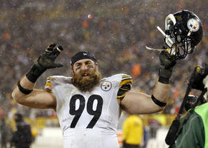 Photo - Pittsburgh Steelers' Brett Keisel celebrates after an NFL football game against the Green Bay Packers Sunday, Dec. 22, 2013, in Green Bay, Wis. The Steelers won 38-31. (AP Photo/Jeffrey Phelps)