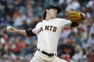 Photo - San Francisco Giants starting pitcher Tim Lincecum throws against the St. Louis Cardinals in the first inning of a baseball game Tuesday, July 1, 2014, in San Francisco. (AP Photo/Eric Risberg)