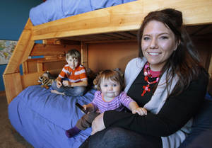 Photo - Miranda Lewis is shown with son, Copper, and daughter, Zuri, in Copper's room at their home near Calumet. The Lewises' former home was destroyed in a May 24, 2011, tornado.  Photo by David McDaniel, The Oklahoman