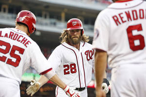 Photo - Washington Nationals' Jayson Werth (28) celebrates his two-run home run with Adam LaRoche (25) and Anthony Rendon (6) during the fourth inning of a baseball game against the Colorado Rockies at Nationals Park, Wednesday, July 2, 2014, in Washington. (AP Photo/Alex Brandon)