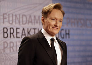 "Photo - FILE - In this Dec. 12, 2013, file photo, talk show host Conan O'Brien arrives for the Breakthrough Prize in Life Sciences awards in Moffett Field, Calif. TBS says Conan O'Brien will be sticking around with his late-night hour through 2018. ""Conan"" premiered on TBS in November 2010. It airs Monday through Thursday at 11 p.m. Eastern time. (AP Photo/Ben Margot, file)"
