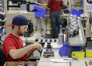 Photo -  Anthony Zingale wires blender motors at the Vitamix manufacturing facility in Strongsville, Ohio.  AP Photo  <strong>Mark Duncan -   </strong>