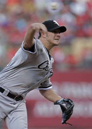 Photo -   Chicago White Sox starterJake Peavy pitches during the first inning of a baseball game against the St. Louis Cardinals, Wednesday, June 13, 2012, in St. Louis.(AP Photo/Tom Gannam)