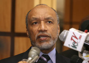 Photo - FILE - In this May 10, 2011 file picture Mohamed Bin Hammam, chief of the Asian Football Confederation, talks to local media in Port of Spain, Trinidad & Tobago.  Organizers of the 2022 World Cup in Qatar have distanced themselves from fresh allegations of corruption surrounding the Gulf nation's winning bid for the tournament in 2010. The Tuesday March 18, 2014  edition of British newspaper The Daily Telegraph alleges it has evidence that former FIFA vice president Jack Warner and his family were paid almost $2 million from a company controlled by Mohamed Bin Hammam, a Qatari who used to be an executive committee member of world football's governing body   (AP Photo/Shirley Bahadur, File)