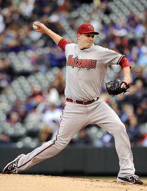 Photo -   Arizona Diamondbacks starting pitcher Trevor Cahill throws in the first inning of a baseball game against the Colorado Rockies on Sunday, April 15, 2012 in Denver. (AP Photo/Chris Schneider)