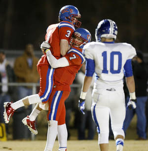 photo - Oklahoma Christian School's Will McKinnis , left, and Blake Barnes celebrate after McKinnis caught a touchdown pass against Stroud during a high school football playoff game in Edmond, Friday, Nov. 23, 2012. Photo by Bryan Terry, The Oklahoman