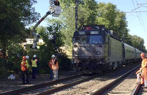 Photo - In this photo provided by the Massachusetts Bay Transportation Authority Transit Police via Twitter, officials work at the scene Monday, June 23, 2014, where an Amtrak train struck a vehicle overnight in Mansfield, Mass. Three people in the vehicle were killed. Service on Amtrak and MBTA lines was delayed while the crash was investigated. (AP Photo/Massachusetts Bay Transportation Authority Transit Police)