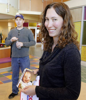 Photo - Kari Hinkel shows off a picture of her 5-month-old daughter Keona before a news conference at Rocky Mountain Hospital for Children in Denver on Wednesday, Jan. 16, 2013. The youngster is being treated at the hospital for Botulism. Looking on at left is her husband Brian. Keona may have been infected from honey.  (AP Photo/Ed Andrieski)