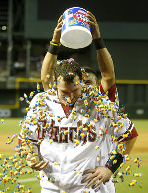 Photo - Arizona Diamondbacks first baseman Paul Goldschmidt (44), right, gets bubble gum poured on him after hitting a walk off homerun against the Baltimore Orioles during a baseball game on Tuesday, Aug. 13, 2013, in Phoenix. (AP Photo/Rick Scuteri)