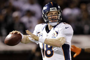 Photo - Denver Broncos quarterback Peyton Manning throws against the Oakland Raiders during the second quarter of an NFL football game in Oakland, Calif., Thursday, Dec. 6, 2012. The Broncos won 26-13. (AP Photo/Marcio Jose Sanchez)
