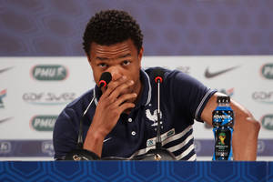 Photo - France's player Loic Remy attends a press conference in Ribeirao Preto, Brazil, Friday, June 13, 2014. France is in group E at the World Cup soccer tournament and plays its first match Sunday. (AP Photo/David Vincent)