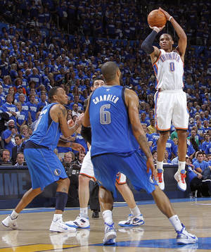 Photo - Oklahoma City's Russell Westbrook (0) puts up a three point shot over Tyson Chandler (6) of Dallas during game 3 of the Western Conference Finals of the NBA basketball playoffs between the Dallas Mavericks and the Oklahoma City Thunder at the OKC Arena in downtown Oklahoma City, Saturday, May 21, 2011. Photo by Chris Landsberger, The Oklahoman