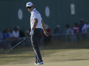 Photo - Justin Rose of England prepares to putt on the 18th green during the second round of the British Open Golf Championship at Muirfield, Scotland, Friday July 19, 2013. (AP Photo/Jon Super)