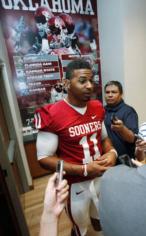 Photo - OU COLLEGE FOOTBALL: R.J. Washington (11) speaks with the media during the Meet the Sooners event at the University of Oklahoma on Saturday, Aug. 4, 2012, in Norman, Okla.  Photo by Steve Sisney, The Oklahoman
