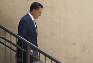 Photo -   Republican presidential candidate, former Massachusetts Gov. Mitt Romney leaves a fundraiser that included Gov. Bobby Jindal, R-La., on Monday, July 16, 2012 in Baton Rouge, La. (AP Photo/Evan Vucci)