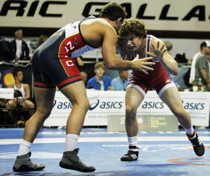Photo - Alex Dieringer (right) grapples for position with Taylor Massa (left) in a match at the 2013 FILA Junior World Team Trials on June 23, 2013 held at Gallagher Iba Arena in Stillwater, Okla. Photo by KT KING, The Oklahoman